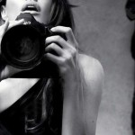 Angelina Jolie photographing herself in Marie Claire January 2012