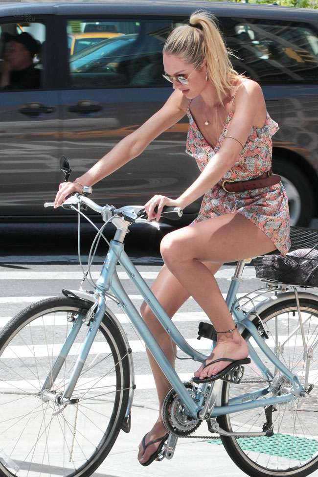 Candice Swanepoel around town on her bike