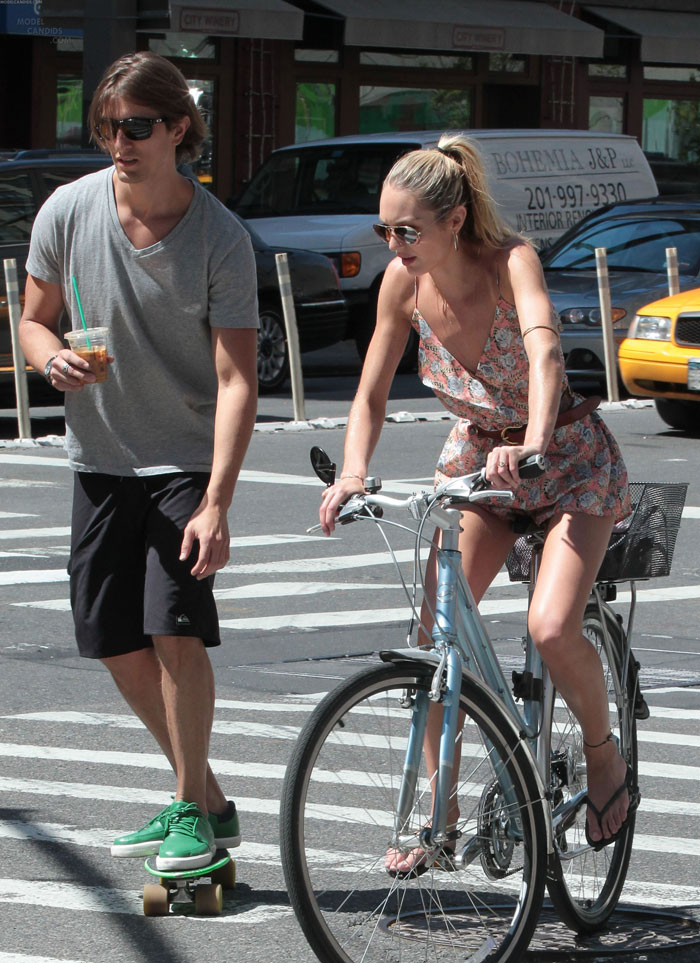 Candice Swanepoel rides bike with boyfriend