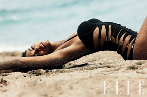Chanel Iman curved on the beach for Elle
