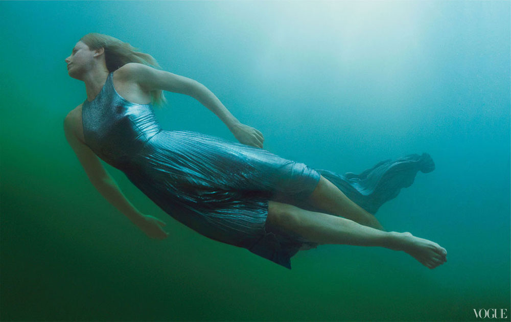 Charlize Theron swimming for Vogue
