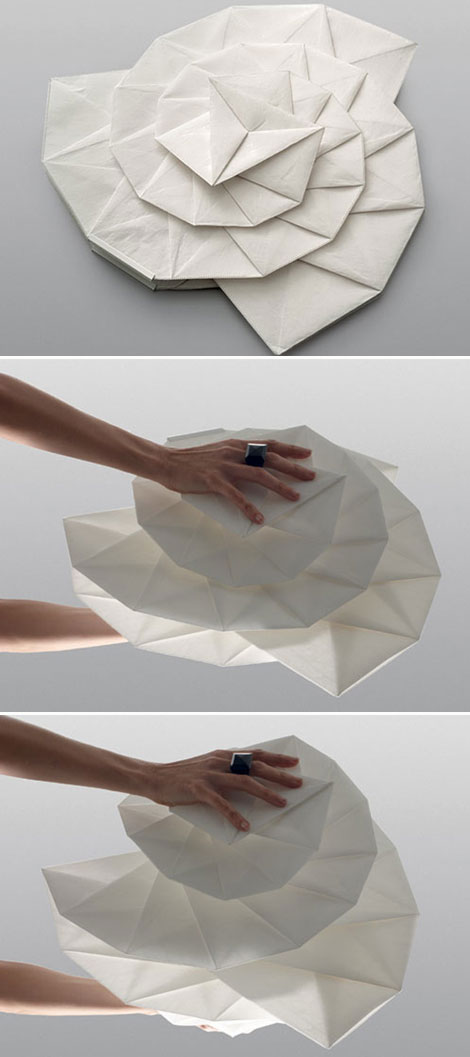 Issey Miyake designed foldable recycled lamp with Artemide