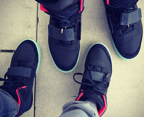 Kanye West shows his Nike Yeezy 2 sneakers with Kim Kardashian