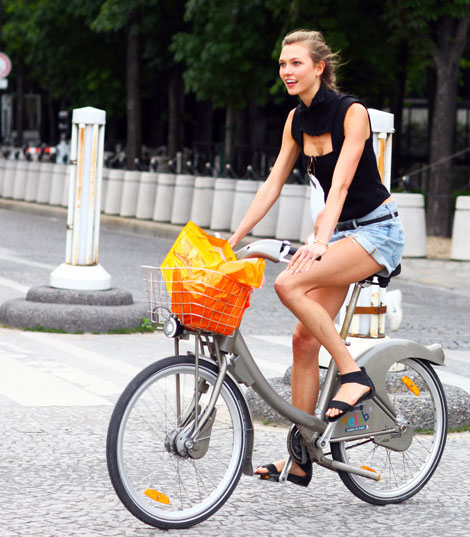 Karlie Kloss on her Bicycle around Paris