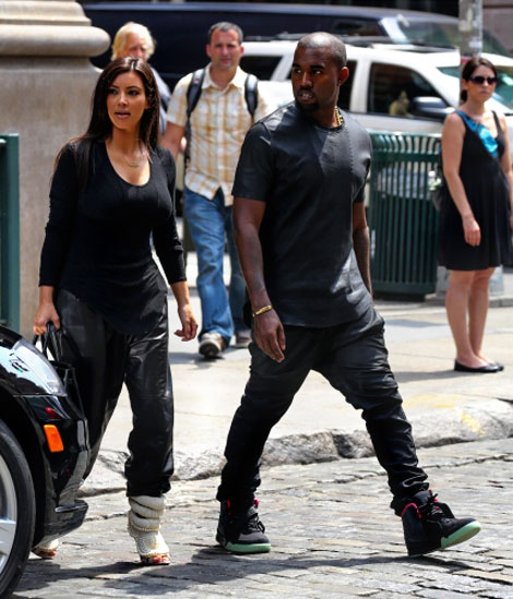 Kim Kardashian matching outfits with Kanye West wearing his shoes