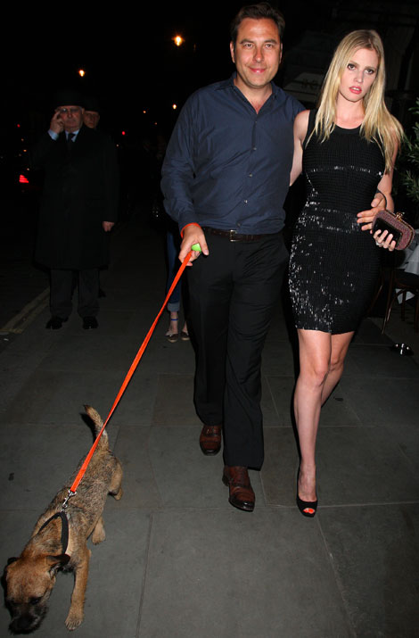 Lara Stone with husband and their dog
