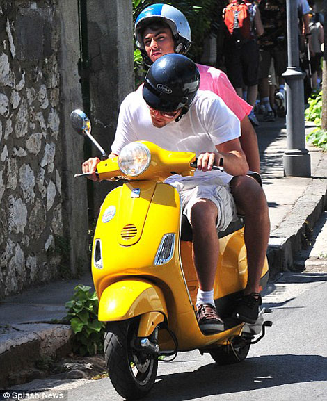 Leonardo Di Caprio yellow scooter