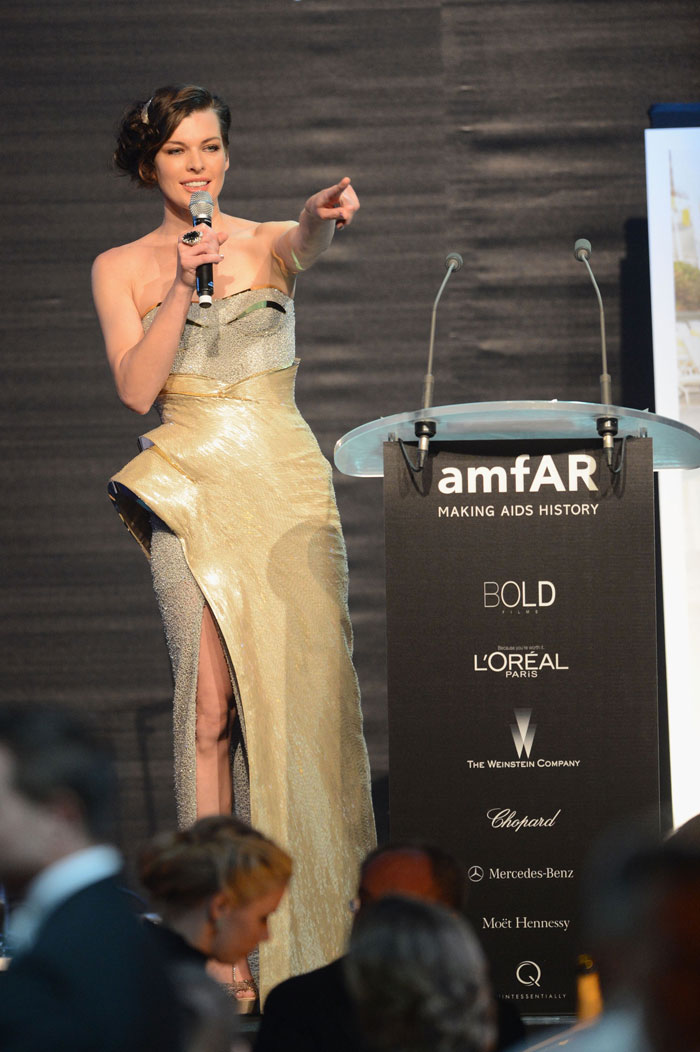 amfAR Red Carpet: Milla Jovovich In Atelier Versace Sparkling Dress