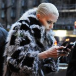 Abbey Lee Kershaw fur coat mobile phone