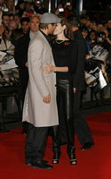 angelina jolie kissing brad pitt at beowulf premiere london