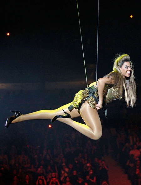 Beyonce hanging above concert crowd