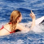 Cara Delevingne surfing friendly