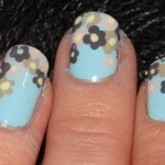 Colored flowers mint nail polish manicure