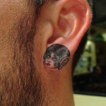 Ear lobe tattoo