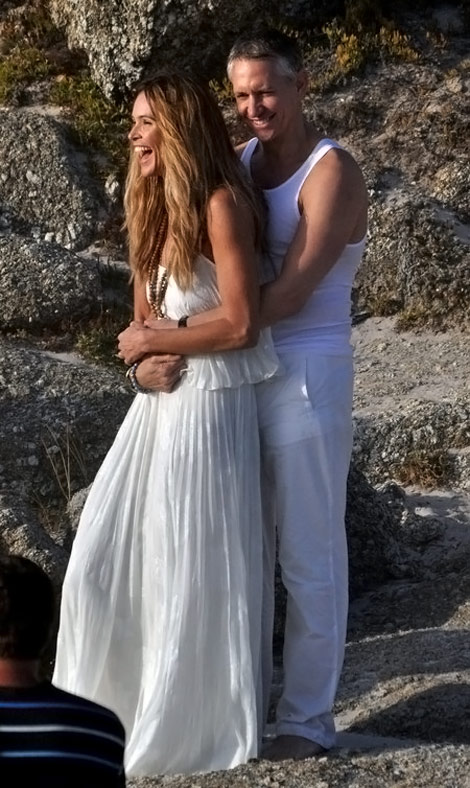 Elle MacPherson Wears White On The Beach