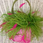 Green feathered pink bag