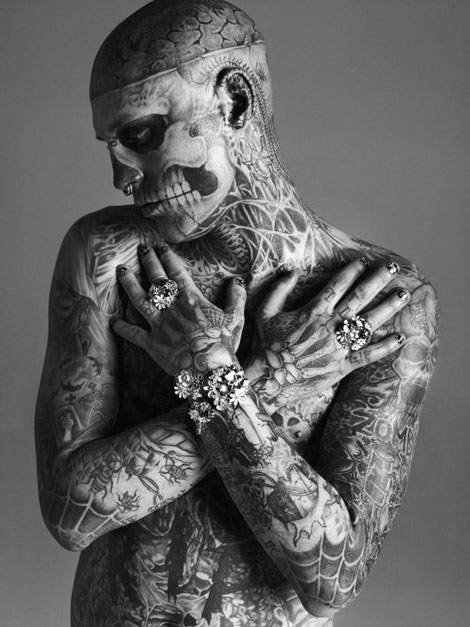 Heavy tattoos and jewelry