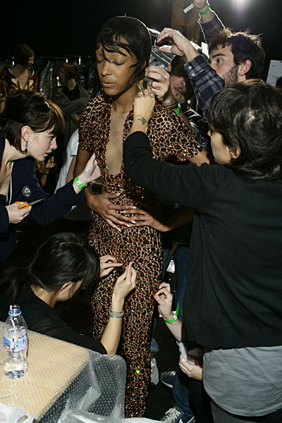 Jourdan Dunn catsuit backstage fittings at Alexander McQueen Spring summer 2009