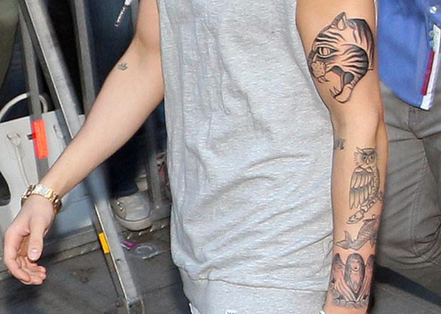 Justin Bieber growing tattoos collection