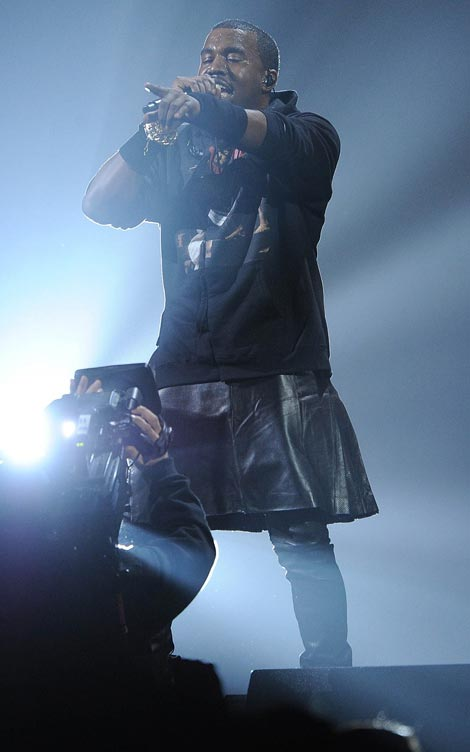 12.12.12. Concert: Kanye Wears Skirt On Stage