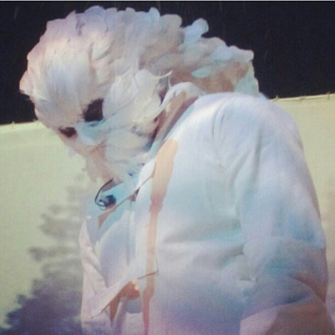 Kanye West feathered mask on stage
