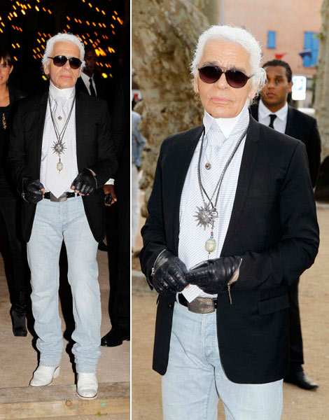 Karl Lagerfeld Wearing Whitewashed jeans and white boots