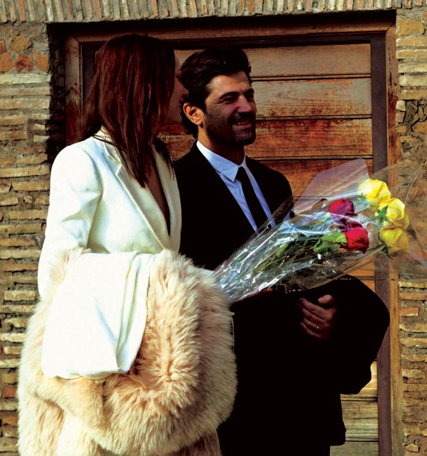 Karmen Pedaru married Riccardo Ruini in white YSL suit