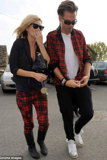 Kate Moss wearing skinny tartan pants and male friend s matching tartan jacket