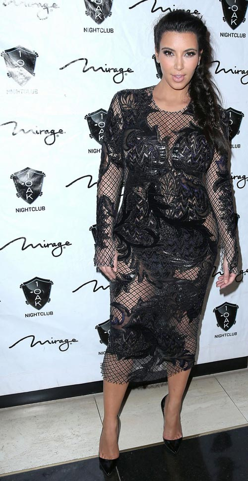 Kim Kardashian pregnant see through dress NYE