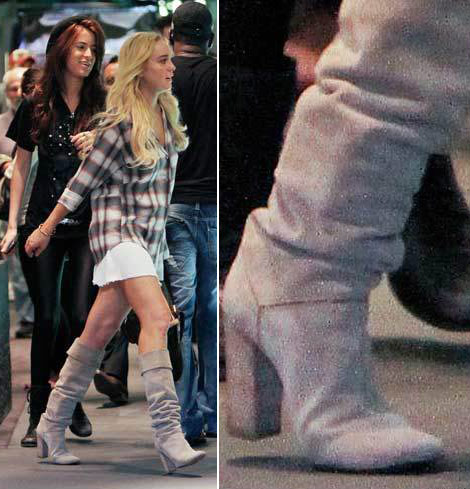 Lindsay Lohan Scram ankle bracelet through boots