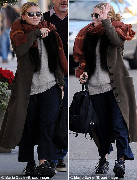Mary Kate Olsen wearing sneakers