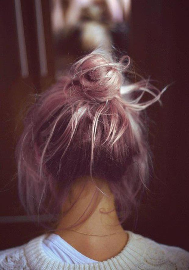 pink hair in a messy bun