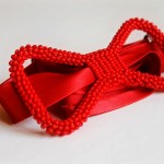 pretty red beaded bow tie by Innocent Creationz