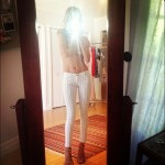 Rosie Huntington Whiteley wears white Cher Coulter AG Jeans no top