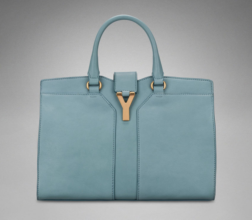 sky blue Yves Saint Laurent bag as worn by Angelina Jolie