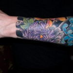 Stefano Pilati Floral arm tattoo large