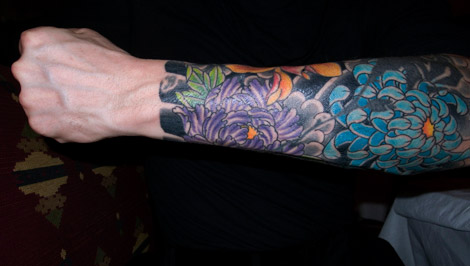 Stefano Pilati Floral arm tattoo