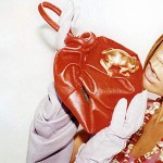 Victoria Beckham for Marc Jacobs Advertising Campaign with Red Purse and Golden Frog